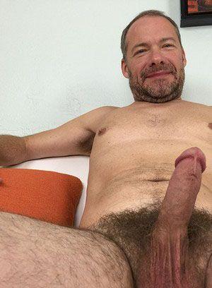 Josh Stanton rubs his meat