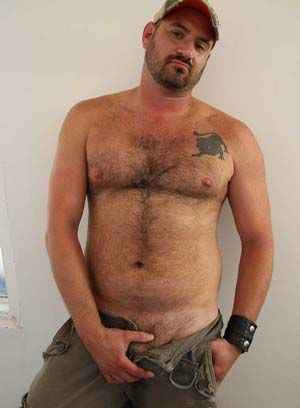 Marc Adams shows off his body