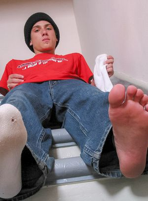 Phillip Ashton shows off his socks and sexy feet
