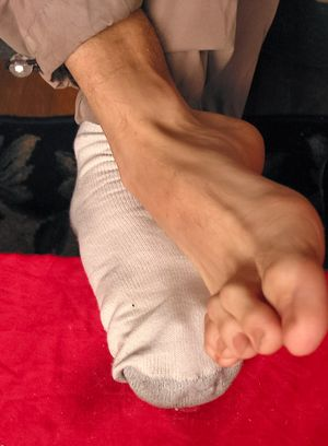 Kelly Cooper shows off his socks and sexy feet