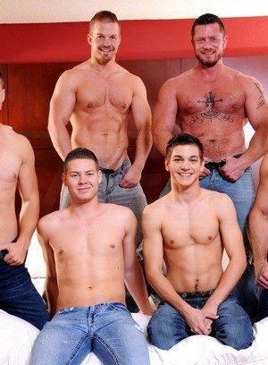 Hungry gay gets bukkake during orgy