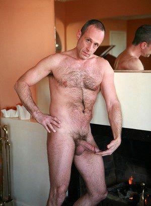 Josh Kole rubs his meat