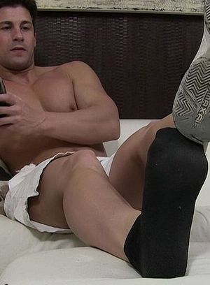 Aldo shows off his socks and sexy feet