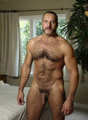 Arpad Miklos rubs his meat