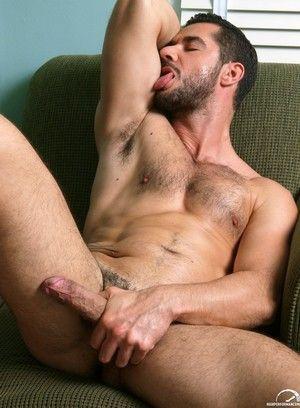Dean Monroe rubs his meat