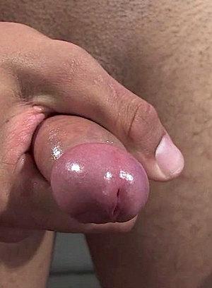 Travis strokes his hard dick