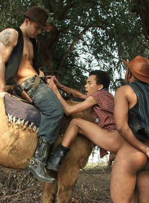 Slim guy bends over to take two cowboy cocks