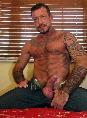 Ray Dalton rubs his meat