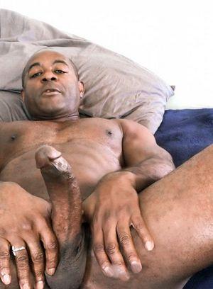 Aaron Trainer strokes his big black dick